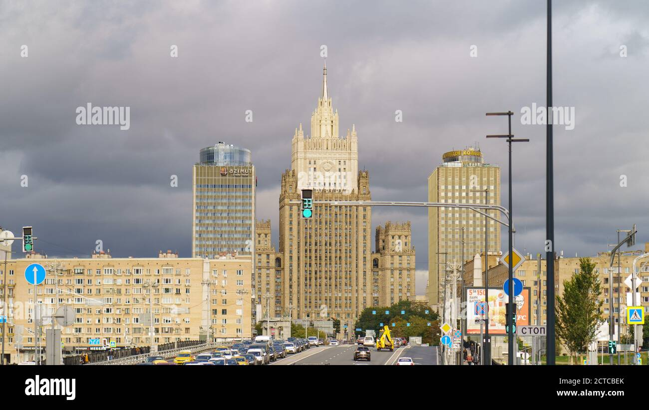 Moscow, Russia - September 9, 2020: Cityscape in autumn day. Stalinist architecture building of Ministry of foreign affairs (MFA) and Borodinsky Bridg Stock Photo