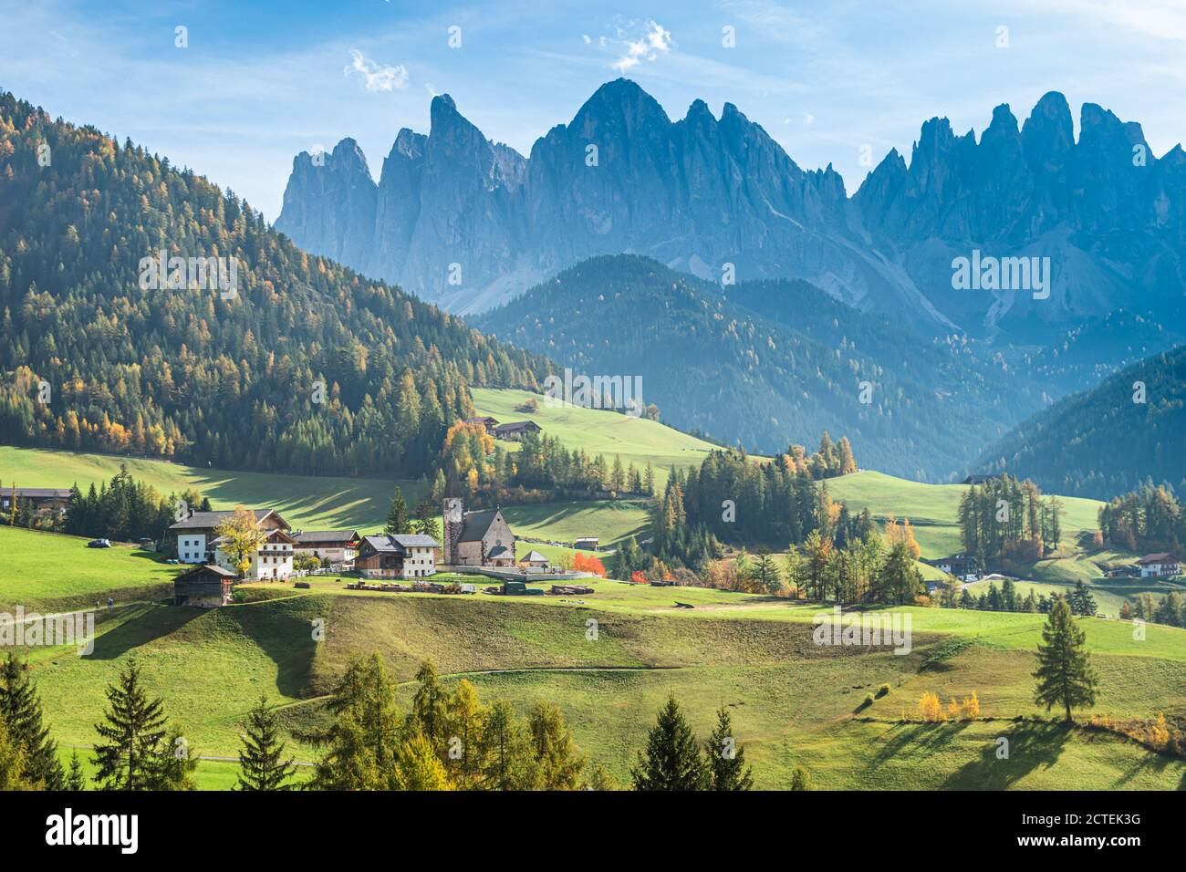 Landscape of early autumn on the church Santa Magdalena in northern Italy on the slopes of the Dolomites in the valley of Val di Funes. Stock Photo