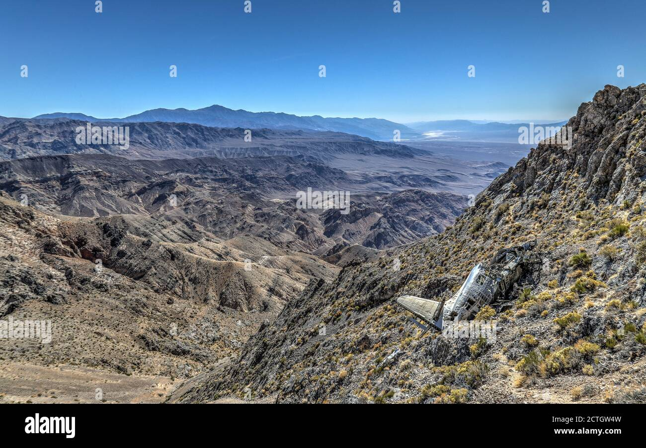 DEATH VALLEY NATIONAL PARK, UNITED STATES - Sep 14, 2018: The remains of a wrecked military plane on a classified flight remain on an isolated mountai Stock Photo