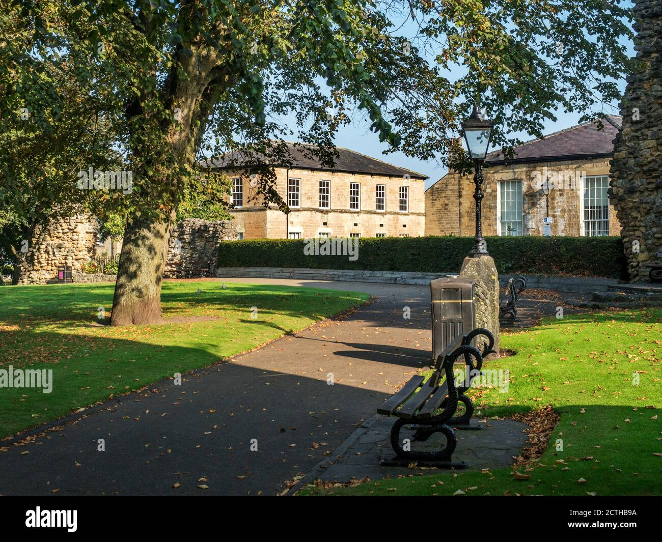 Knaresborough Castle Grounds in early autumn with former National School buildings behind Knaresborough North Yorkshire England Stock Photo
