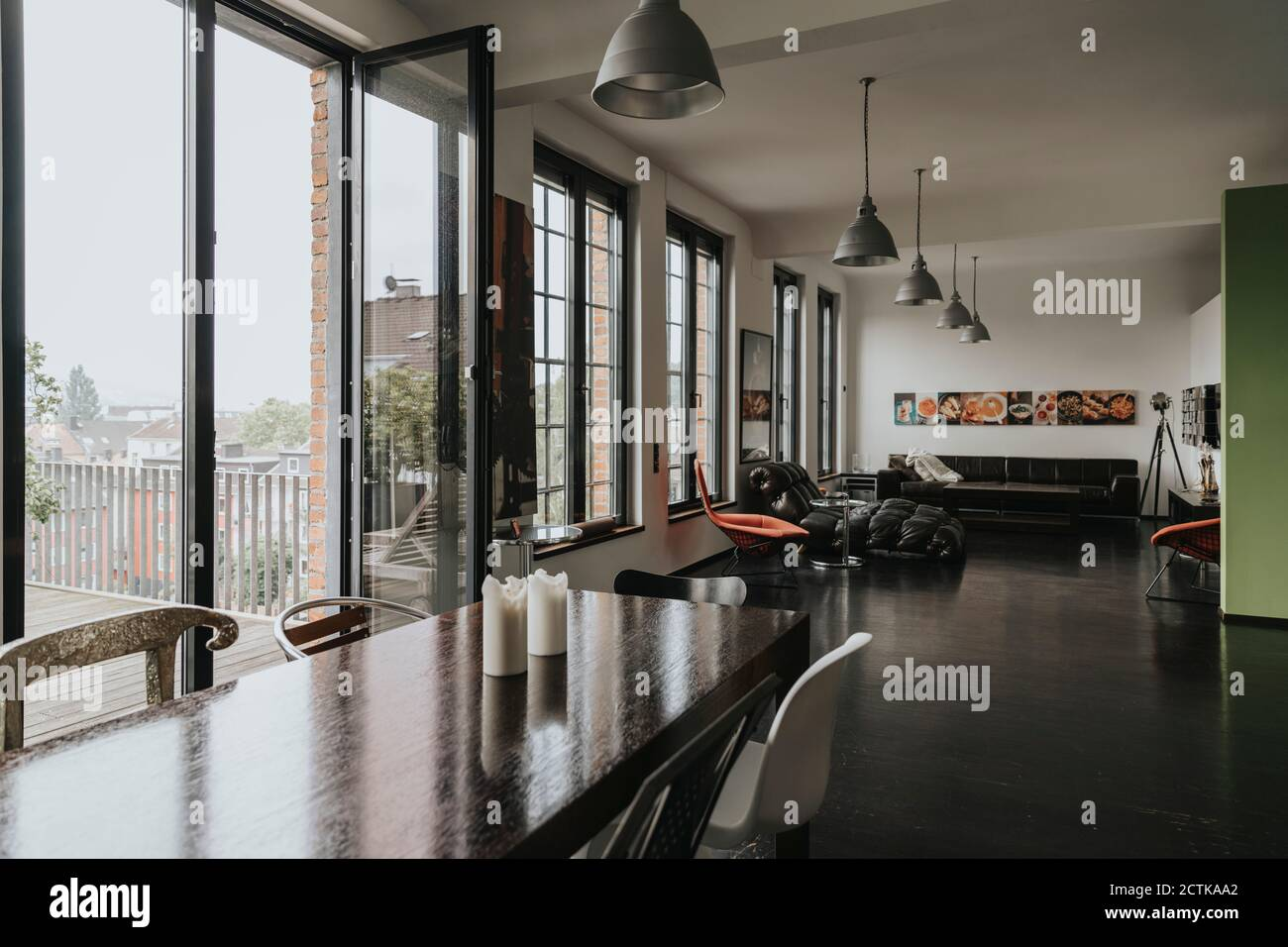 View from dining area to living area in a designer loft Stock Photo