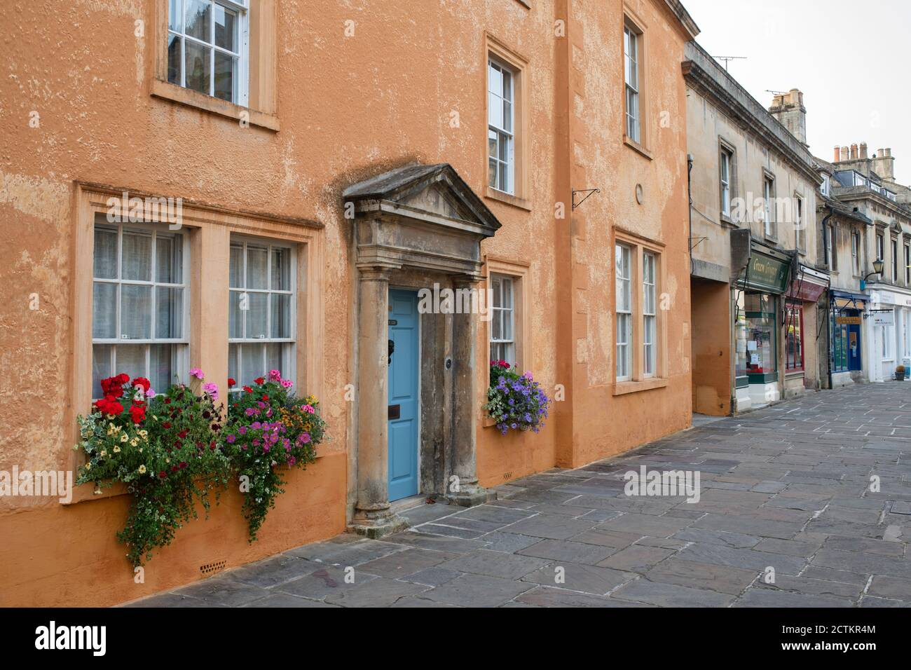 Large coloured house along the pedestrianised high street. Corsham,  Cotswolds, Wiltshire, England Stock Photo