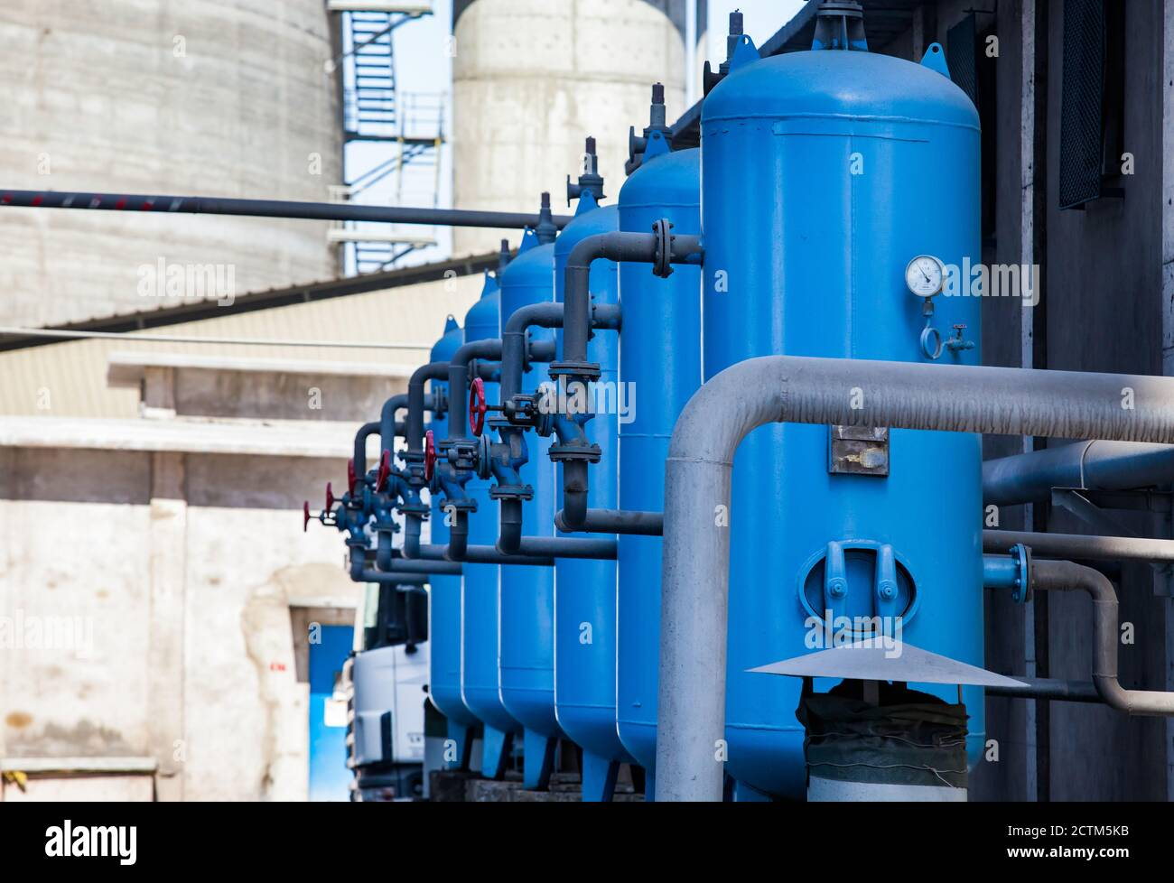 Mynaral/Kazakhstan - April 23 2012: Jambyl Cement plant. Water purification station. Blue water storage tanks with valves and pipes. Stock Photo