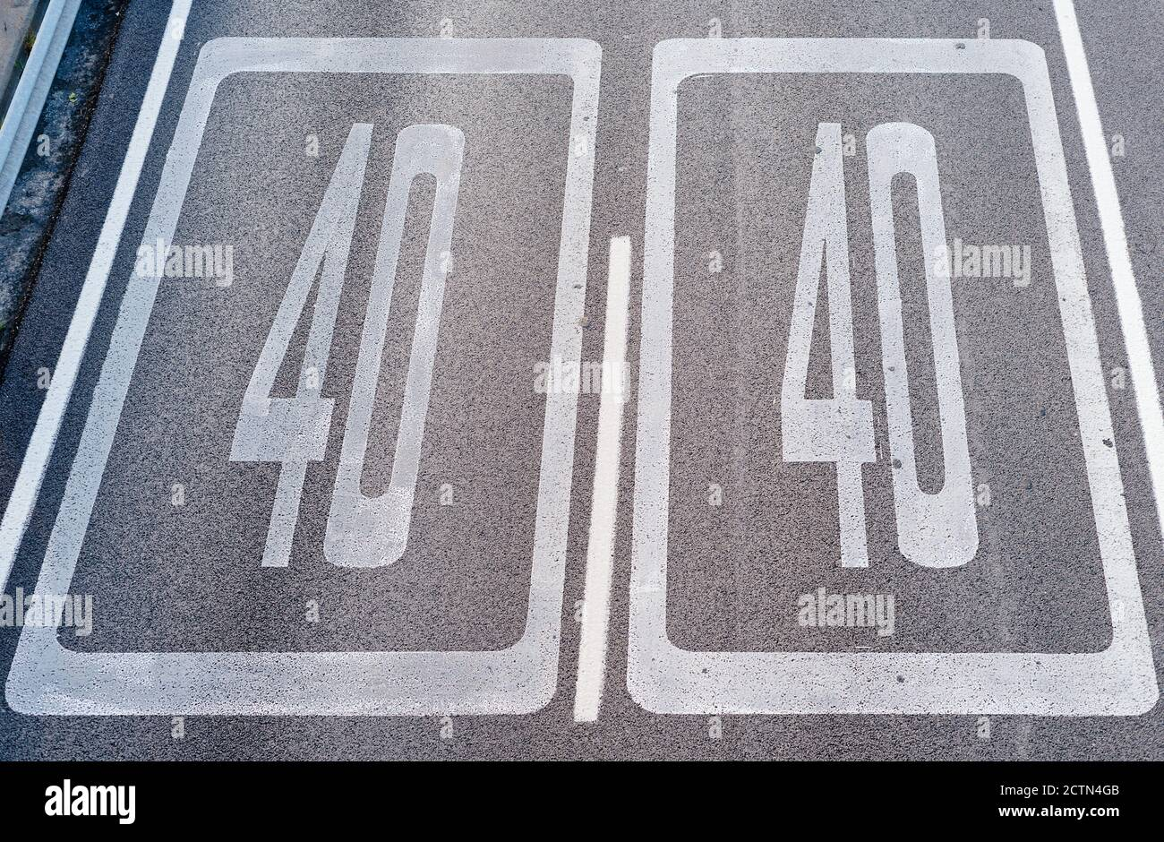 Forty Kilometers or Miles Per Hour Speed Limit Sign in Road Paint. Top view Stock Photo