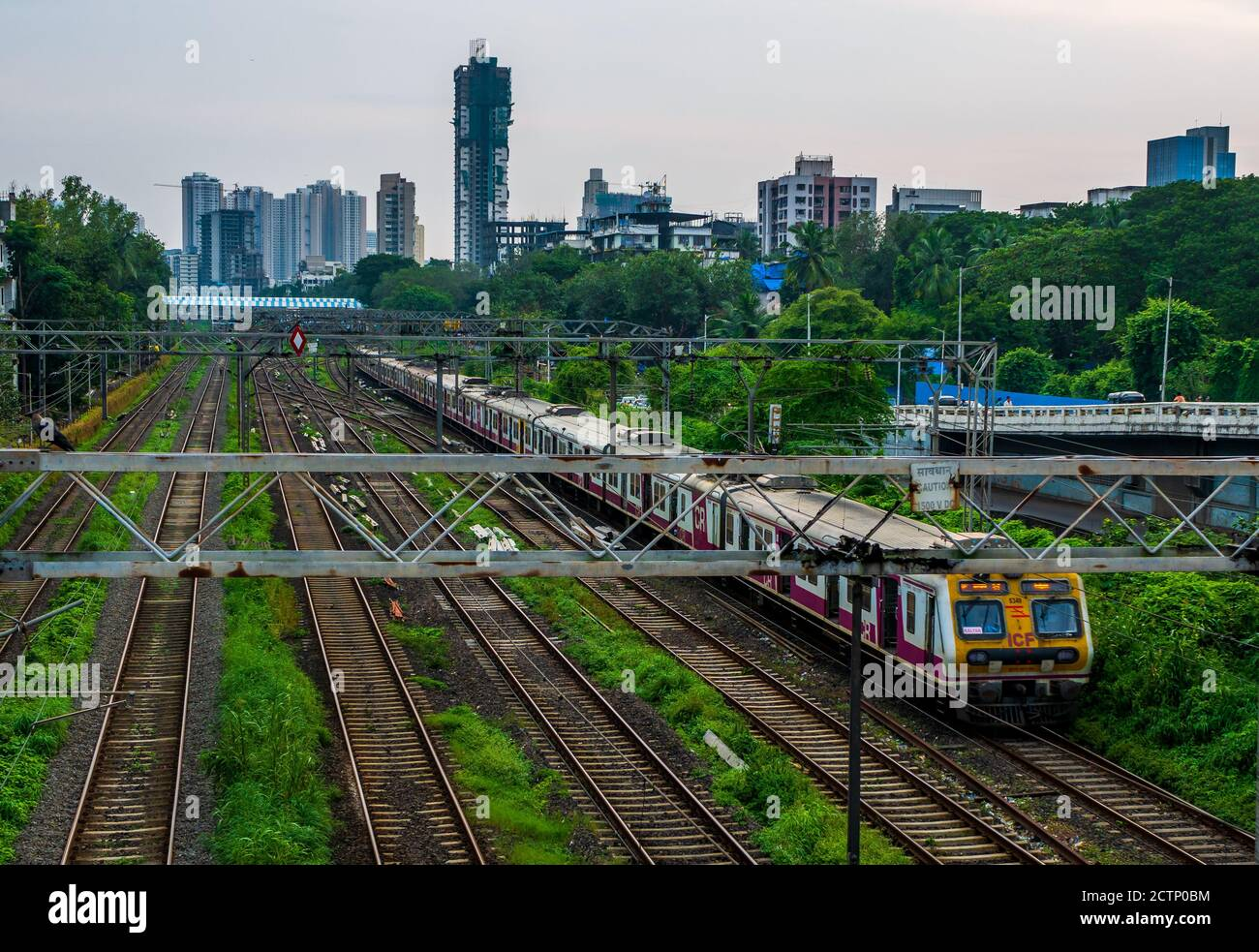 MUMBAI, INDIA - September 20, 2020 : Mumbai Suburban Railway, one of the busiest commuter rail systems in the world having most severe overcrowding in Stock Photo
