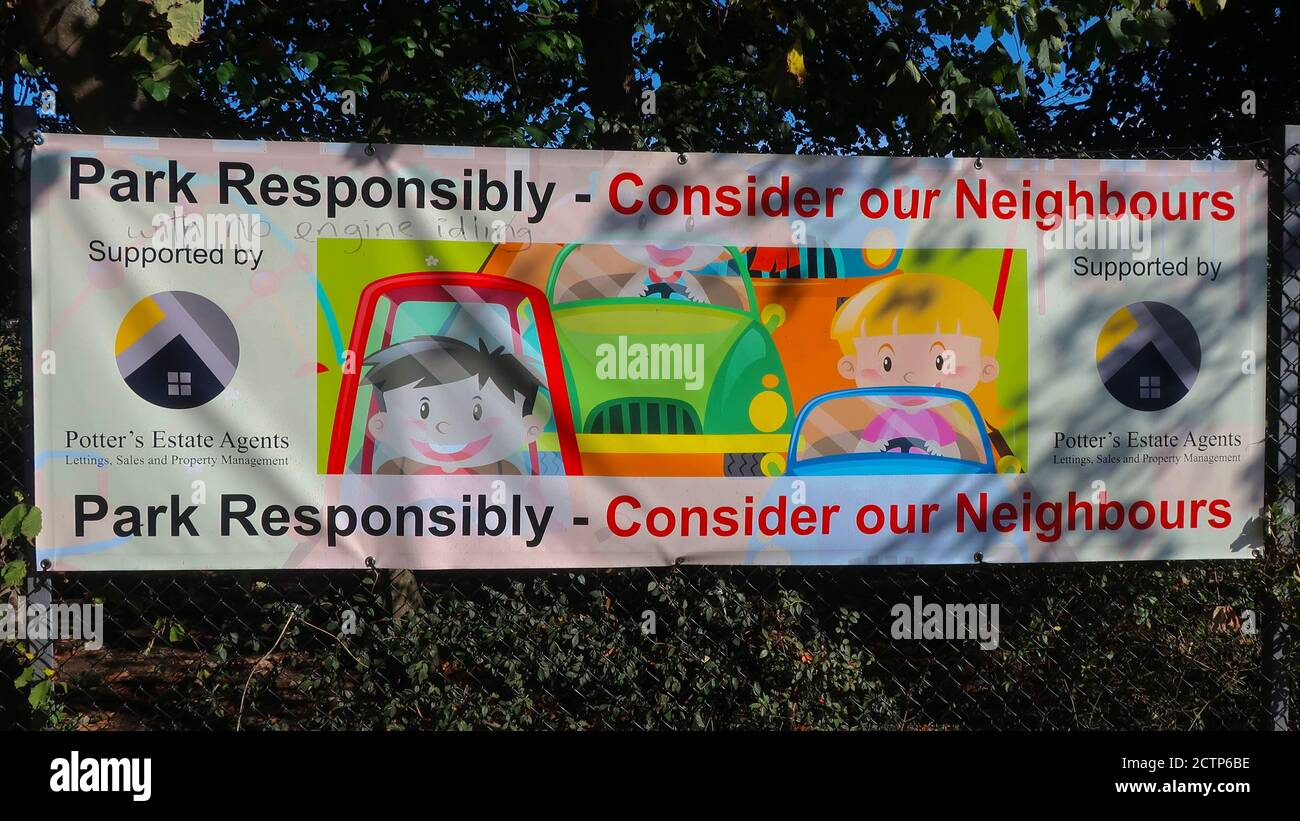 Melton, Suffolk, UK - 24 September 2020: Notice about responsible parking on a primary school fence. Stock Photo