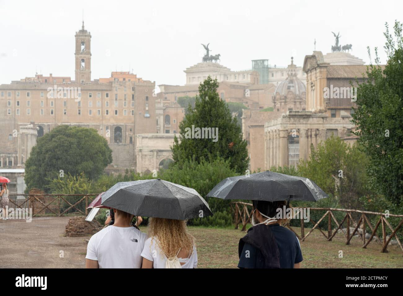 Rome, Italy. 24th September, 2020. Italy Weather: Tourists shelter from heavy rain in the Roman Forum in Rome, Italy. Photo: Roger Garfield/Alamy Live News Stock Photo