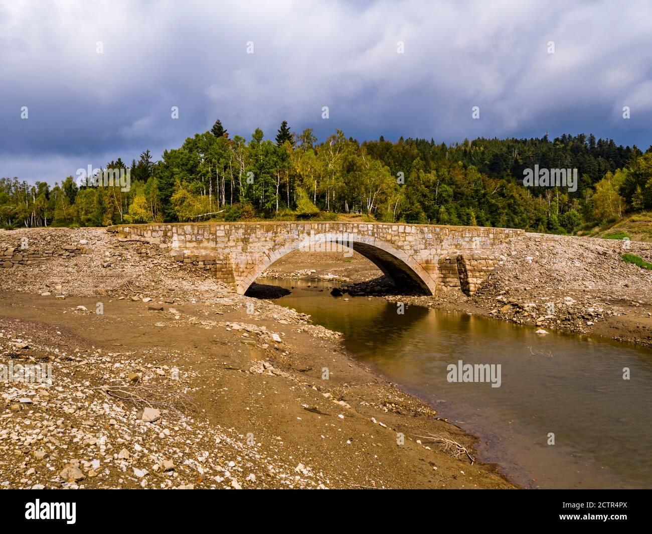 Carov most stone bridge normally under water near Lokvarsko Lokve lake and Mrzla vodica in Croatia Europe Stock Photo