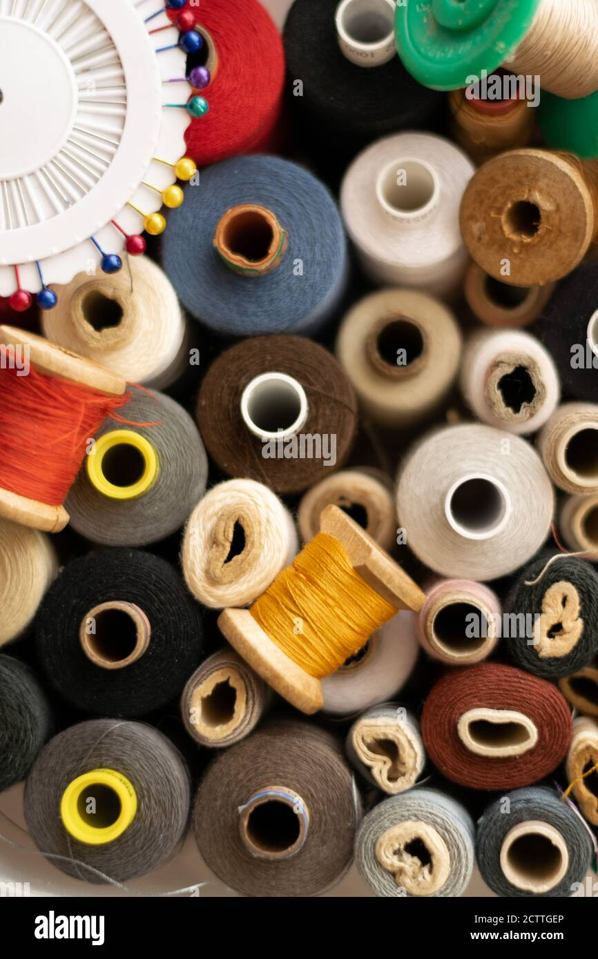 Crop view of different colorful cotton mill, sewing themes Stock Photo