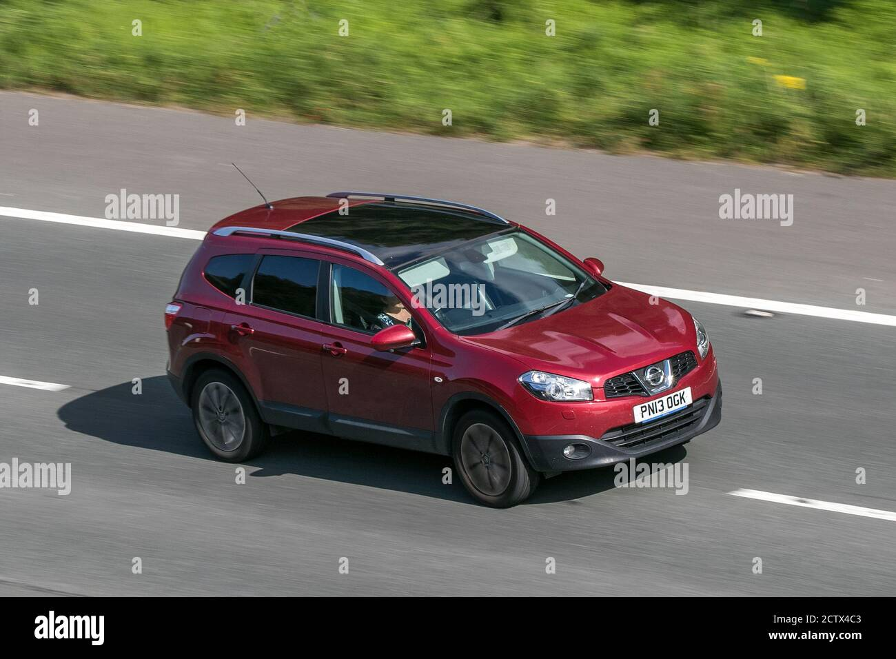 2013 Nissan Qashqai Tekna 2 Dci Red Car Suv Diesel Driving On The M6 Motorway Near Preston In Lancashire Uk Stock Photo Alamy