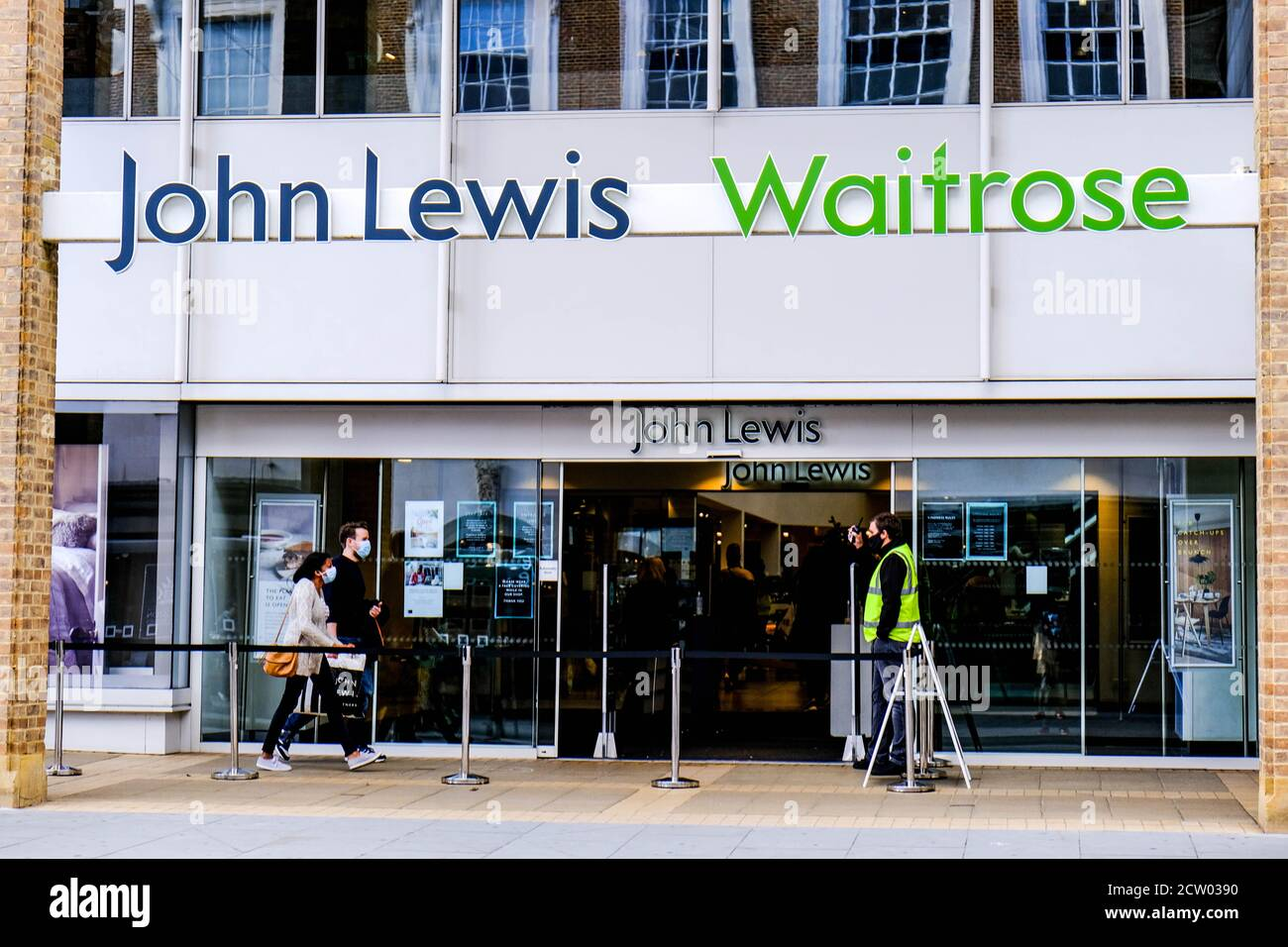 John Lewis Waitrose Department Store Entrance, People Wearing COVID-19 Face Coverings Stock Photo