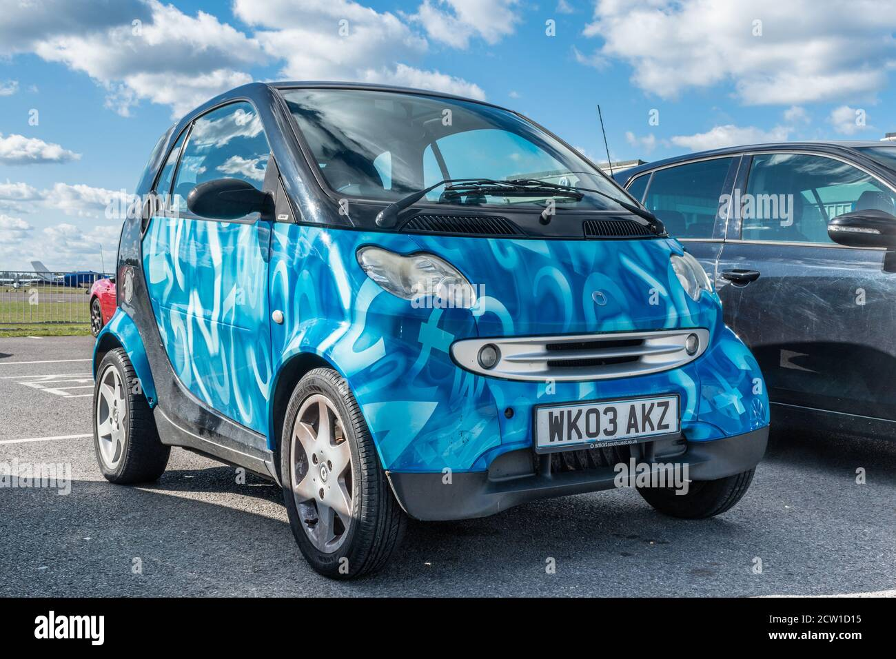 Smart Fortwo car, a two passenger hatchback microcar for city driving manufactured by Daimler Stock Photo