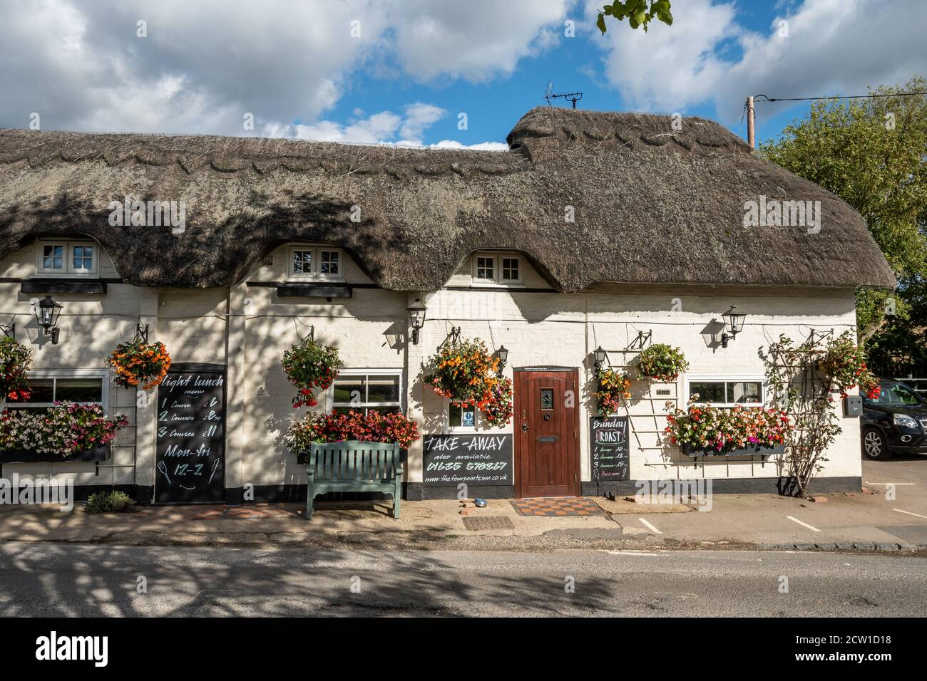 The Four Points Inn, a village pub and restaurant in Aldworth, Berkshire, UK. Exterior of the public house decorated with flowers and hanging baskets Stock Photo