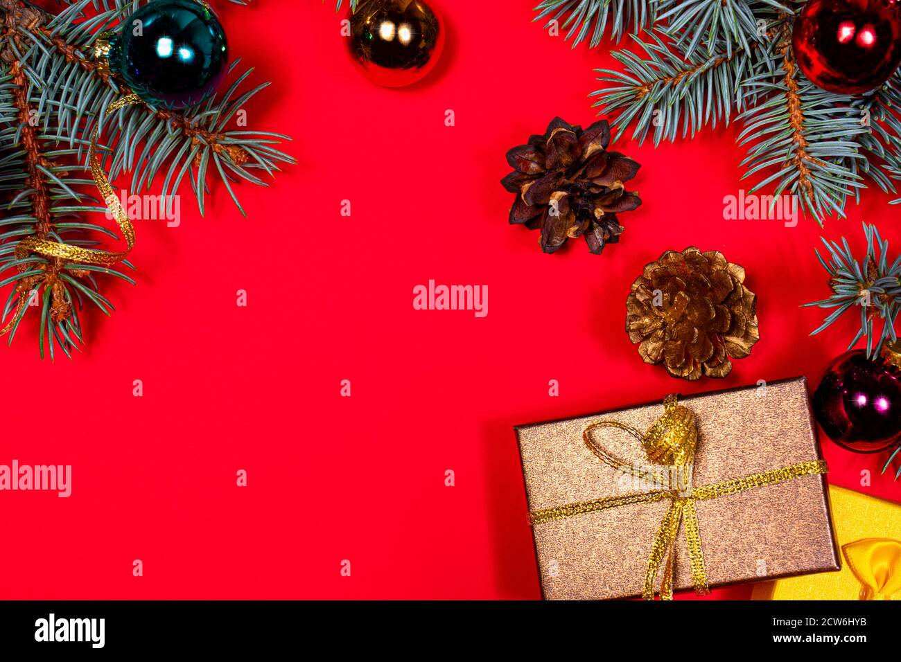 Lots Of Christmas Gifts 2021 Two Christmas Gifts Brown And Yellow Tied With Ribbons Under The Christmas Tree On A Red Background Gifts For New 2021 Stock Photo Alamy