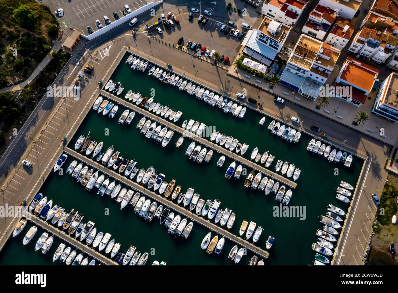 Aerial view of the harbour and boats moored in the fishing village of Llanca on the Costa Brava, Catalonia, Spain Stock Photo