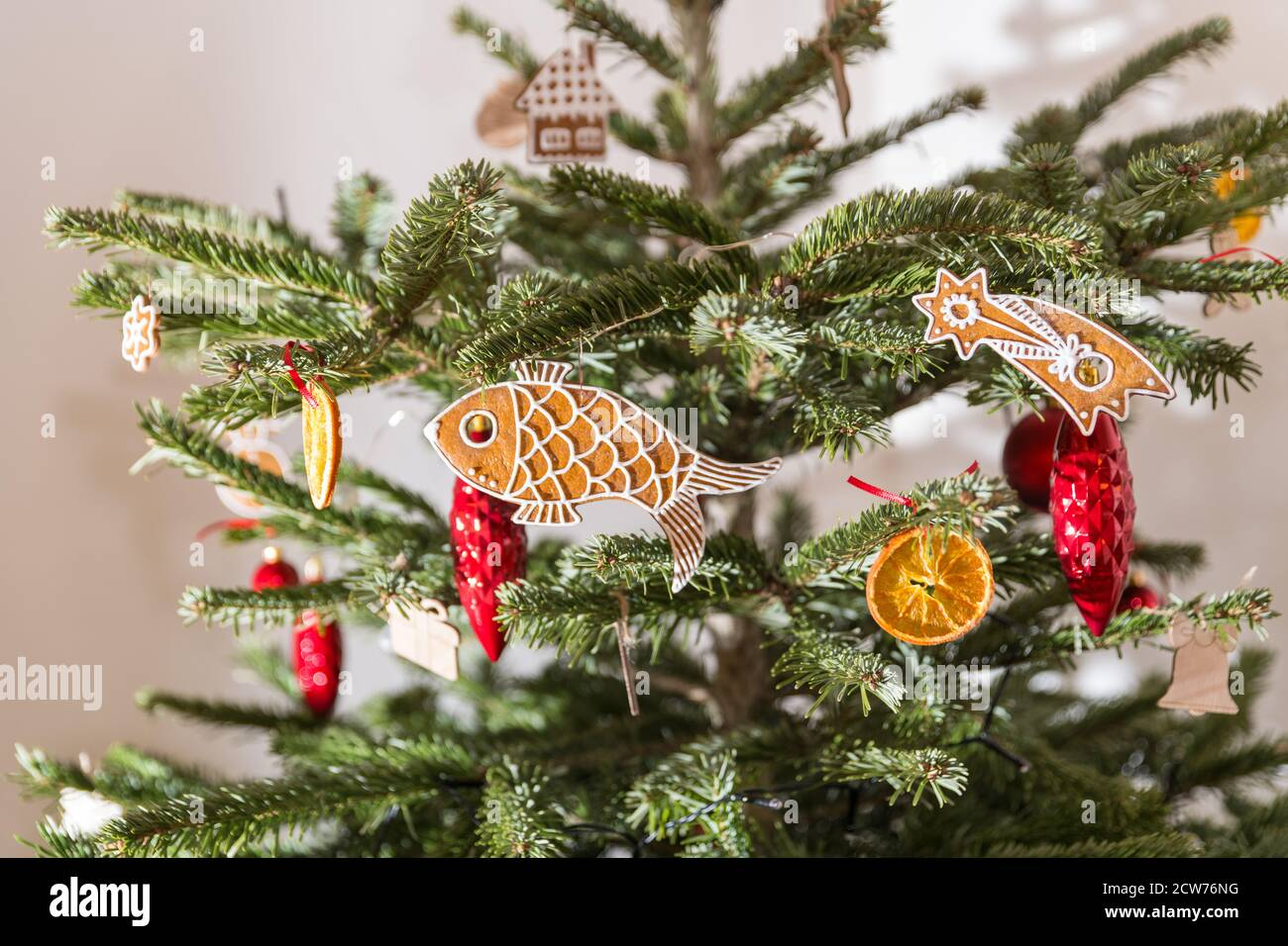 Close Up Of Natural Christmas Tree Decorated In Retro Style Red Decorations And Ornate Baked Gingerbreds Or Dry Orange Slice Hanging On Spruce Branch Stock Photo Alamy
