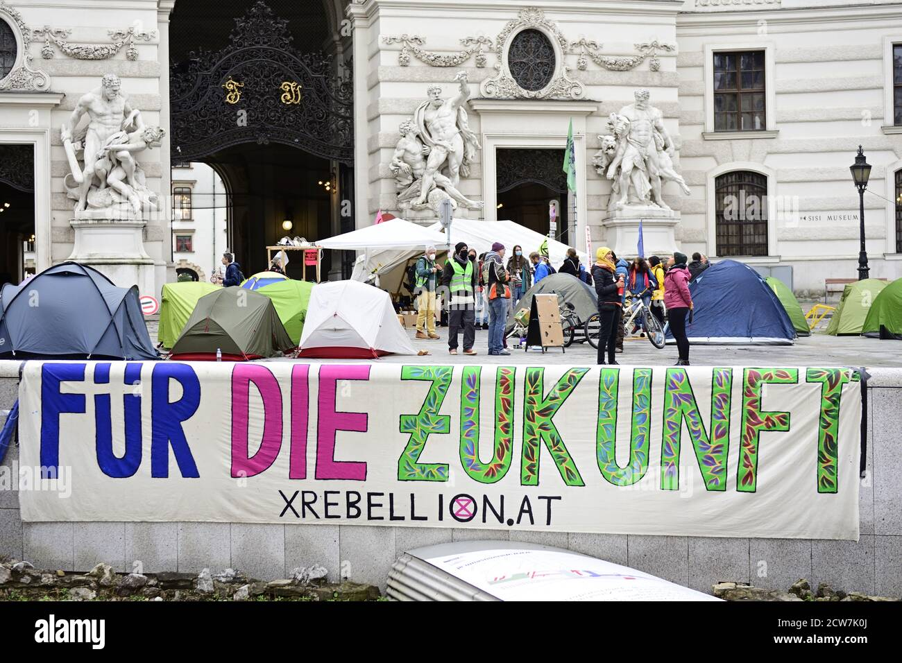 """Vienna, Austria. 28th Sept 2020.  Extinction Rebellion Protest at Michaelerplatz in Vienna. At an event that was not registered according to the police, the activists occupied the square with tents and banners, among other things. Picture shows a banner with the inscription """"For the future"""". Credit: Franz Perc/Alamy Live News Stock Photo"""