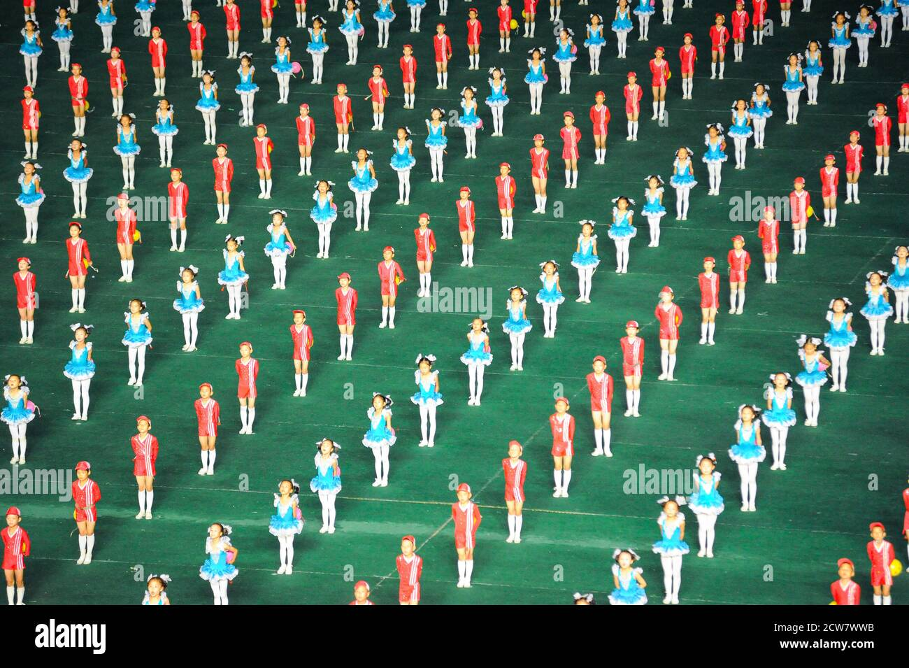 08.08.2012, Pyongyang, North Korea - Mass choreography and Artistic Performance with dancers and acrobats at May Day Stadium during Arirang Festival. Stock Photo