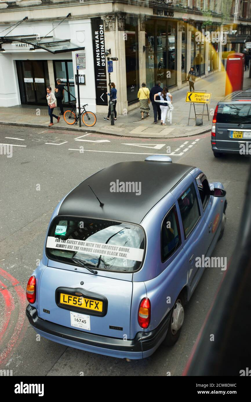 London, UK - July 14, 2017: London Taxi, also called hackney carriage, black cab. Traditionally Taxi cabs are all black in London but now produced in Stock Photo