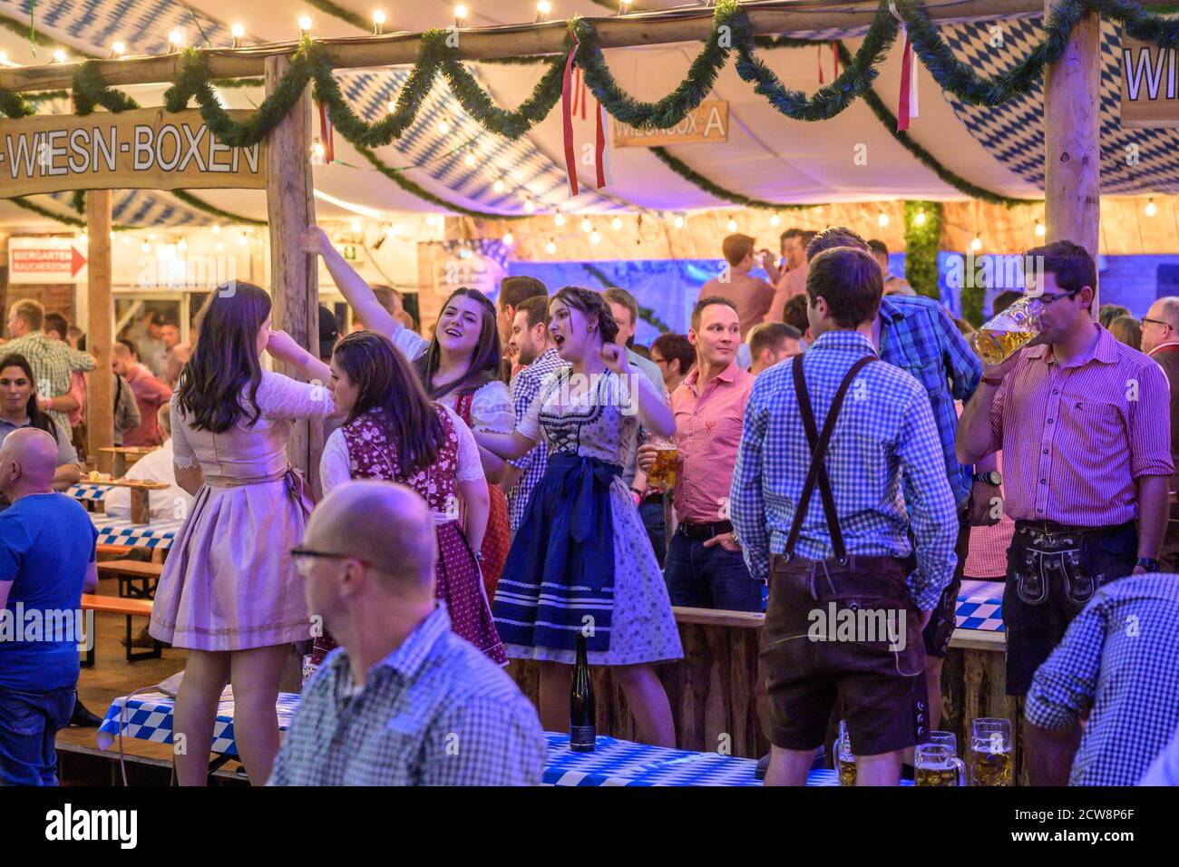 Koblenz Germany 27.09.2019 people party at Oktoberfest in europe during a concert Typical beer tent scene. Stock Photo