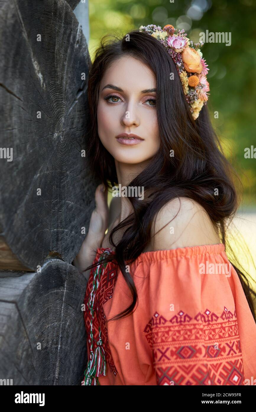 https://c8.alamy.com/comp/2CW95FR/beautiful-slavic-woman-in-an-orange-ethnic-dress-and-a-wreath-of-flowers-on-her-head-beautiful-natural-makeup-portrait-of-a-russian-girl-2CW95FR.jpg