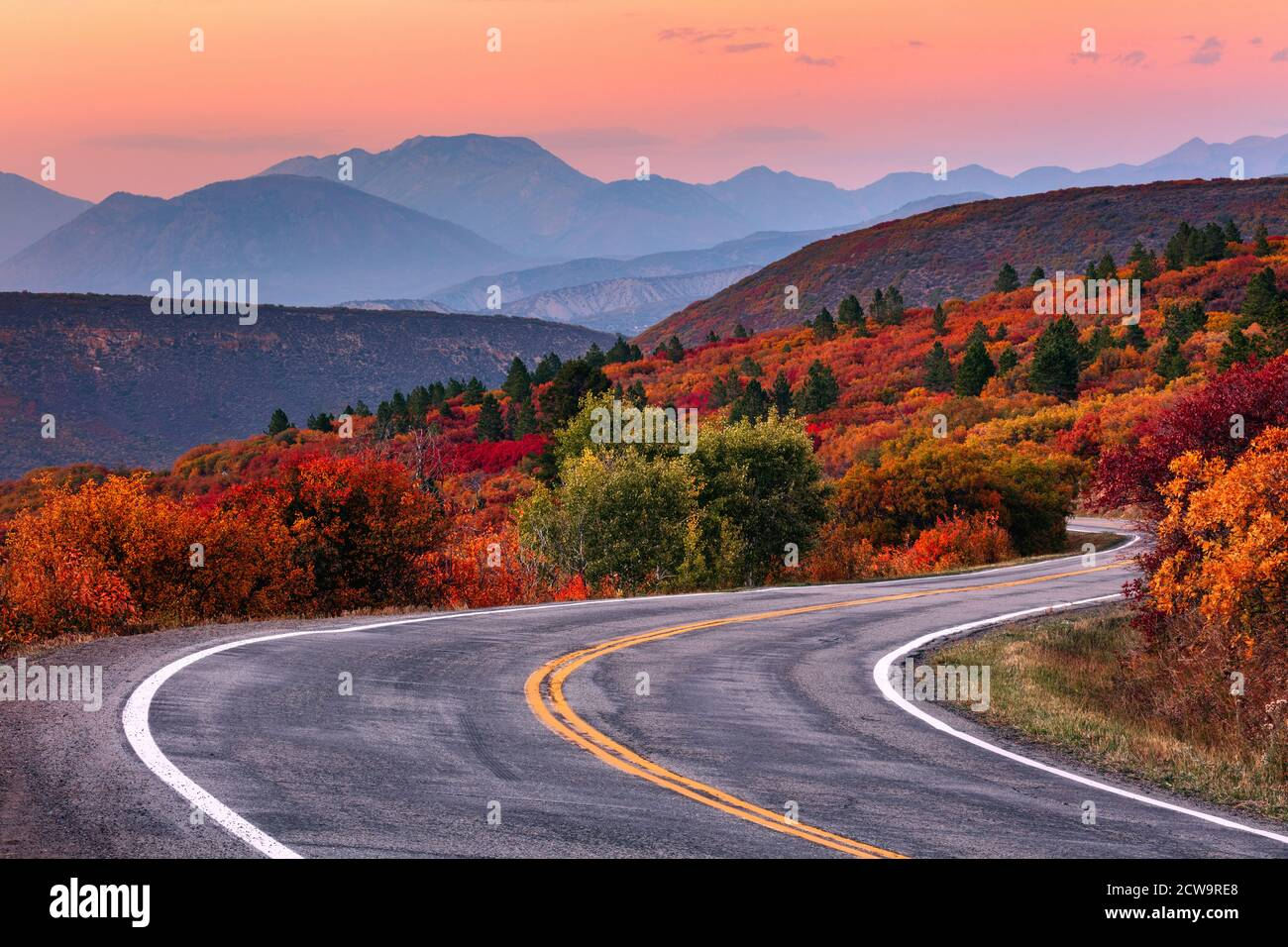 Winding mountain road through a scenic autumn landscape along the West Elk Loop near Gunnison, Colorado. Stock Photo