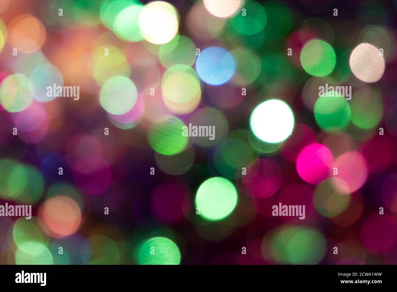 Festive colorful bokeh background with psychedelic colorful sparkles and colorful dots as perfect background for silvester, celebration happy new year Stock Photo