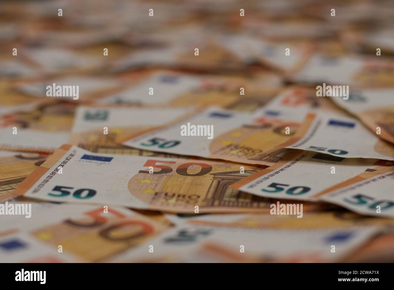 A lot of 50 euro banknotes spread out over the floor. You can use this as a unique background. Also copy space available. Stock Photo