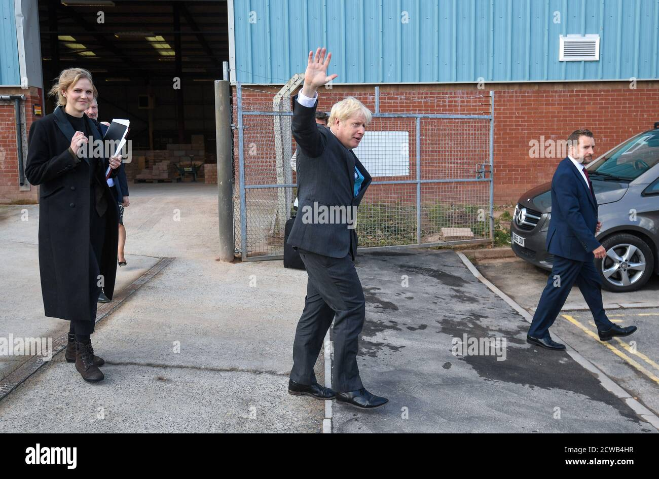 Prime Minister Boris Johnson Waves As He Leaves After Delivering A Speech During A Visit To