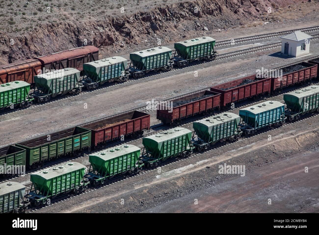Mynaral/Kazakhstan - April 23 2012: Jambyl Cement plant. Hopper car train at loading terminal (station). Aerial view. Stock Photo