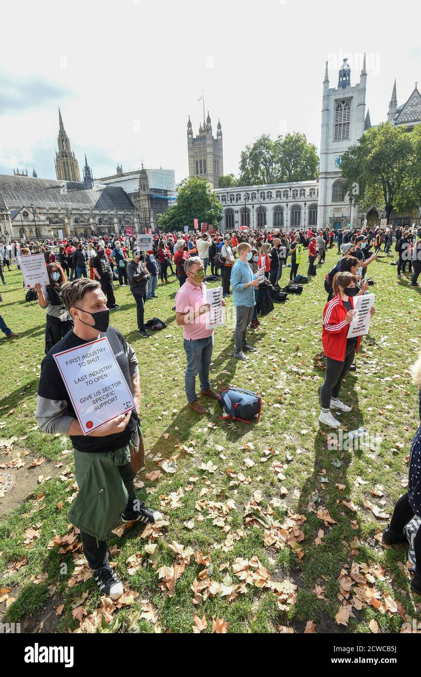 "London, UK. 29th Sept 2020. Events Industry workers gather for the silent protest #WeMakeEvents - ""Stand As One"" at Parliament Square In London, United Kingdom on 29th September 2020. Photo by Tabatha Fireman/Female Perspective/Alamy Live News Stock Photo"
