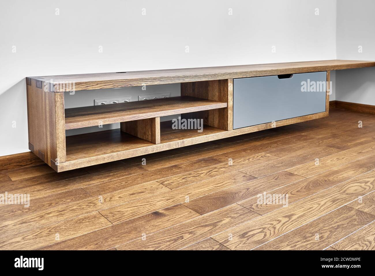 Modern Furniture Wall Mounted Media Cabinet Box Joint Media Cabinet In Living Room Stock Photo Alamy