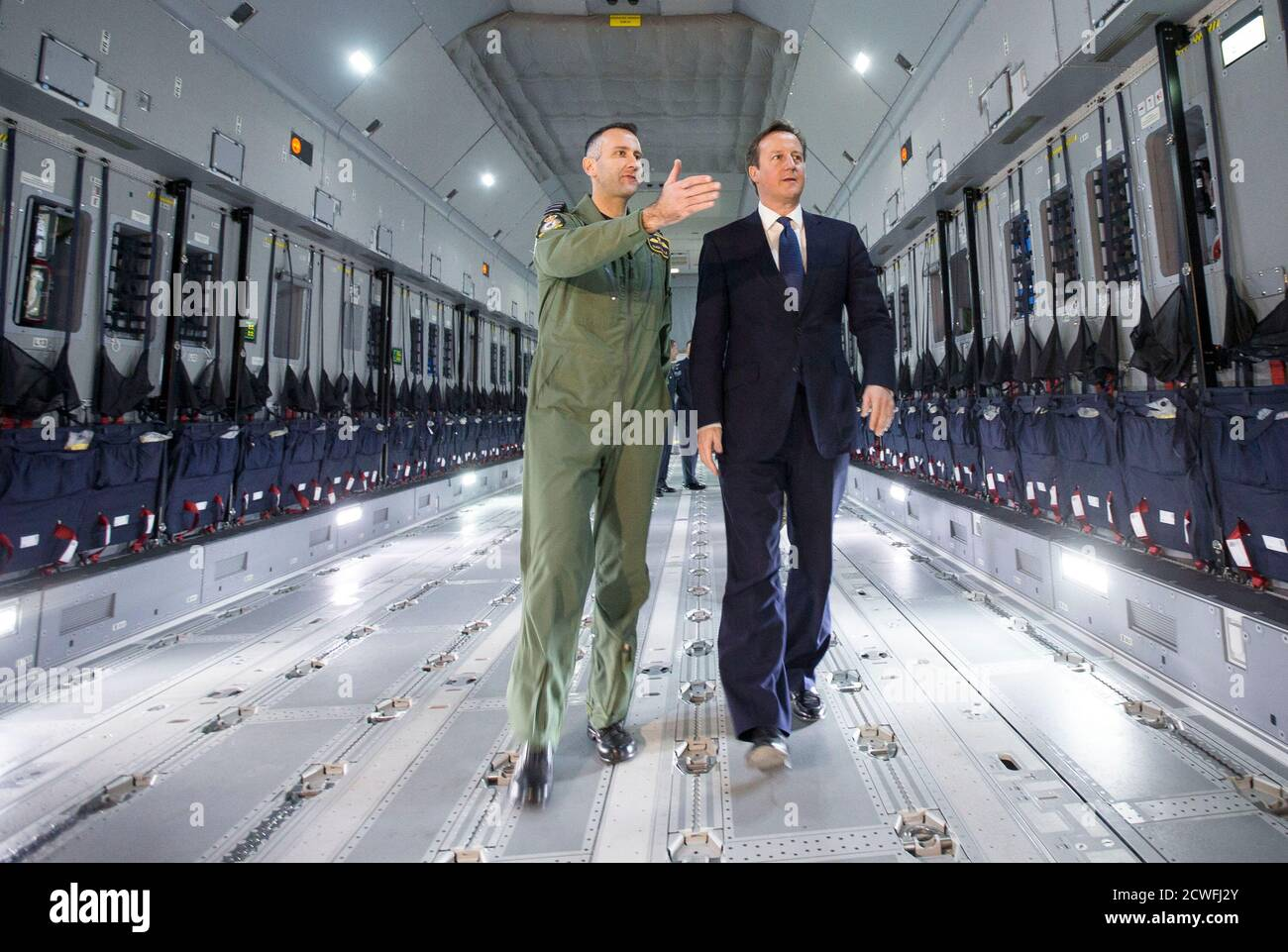 Britain's Prime Minister David Cameron views a newly delivered A400M Atlas aircraft with wing commander Simon Boyle at RAF Brize Norton, central England, November 27, 2014. The RAF will take delivery of 22 of the A400M aircraft. REUTERS/Peter Nicholls (BRITAIN - Tags: POLITICS MILITARY) Stock Photo