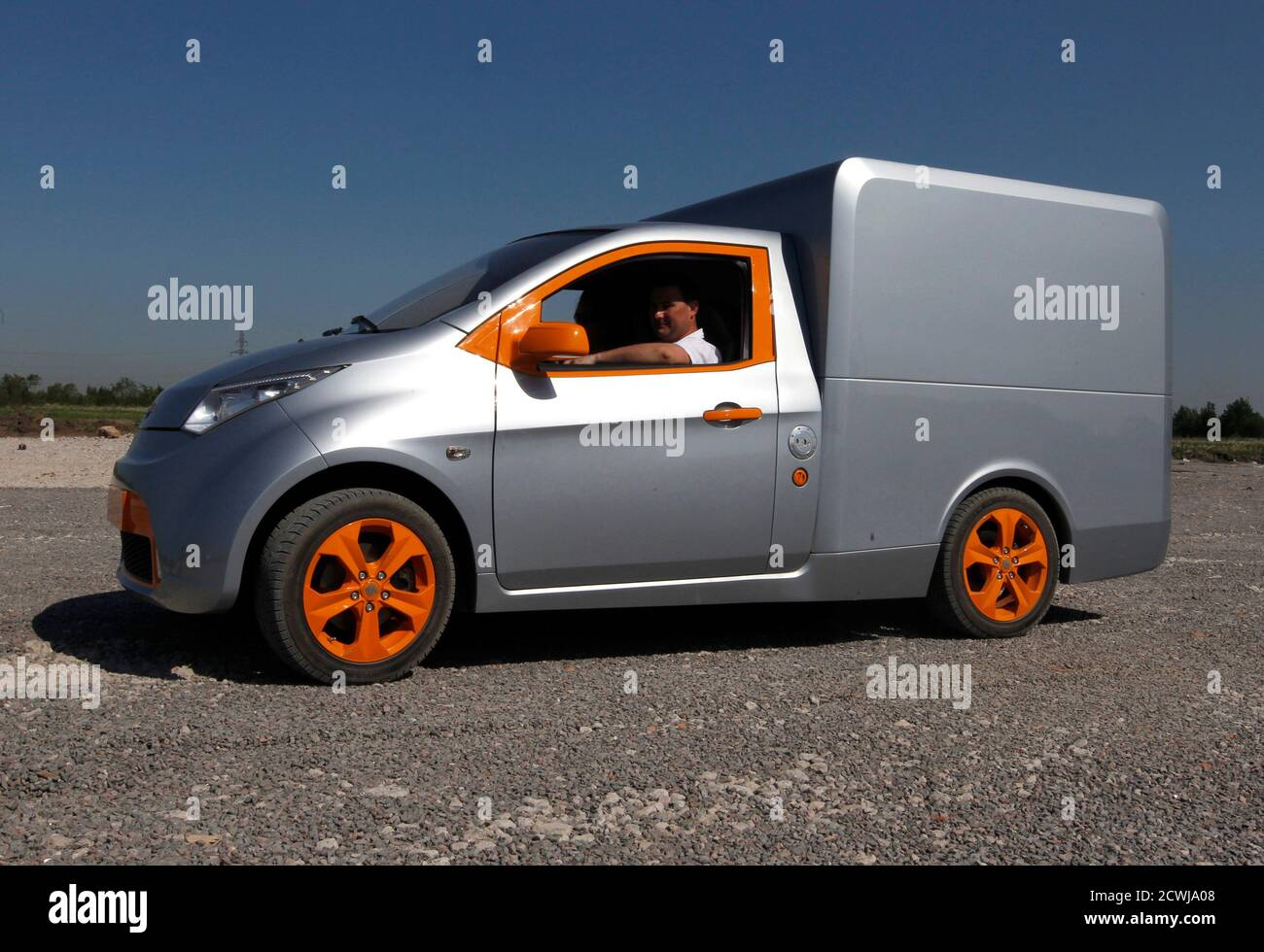 """A Furgon automobile is displayed during a ceremony to start the construction of the plant to produce Russian new car brand """"e"""" automobiles, designed by Onexim Group company, owned by billionaire Mikhail Prokhorov, outside St. Petersburg June 8, 2011. Russian new car brand """"e"""" (""""e with two dots above"""" is the seventh letter in Russian alphabet) automobiles will become the world's cheapest hybrids, priced at $10,000, according to the company's representatives.  REUTERS/Alexander Demianchuk  (RUSSIA - Tags: BUSINESS TRANSPORT CONSTRUCTION) Stock Photo"""