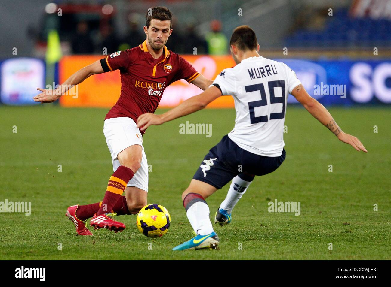 AS Roma's Miralem Pjanic (L) and Cagliari's Nicola Murru fight for the ball during their Italian Serie A soccer match at the Olympic stadium in Rome November 25, 2013. REUTERS/Giampiero Sposito (ITALY - Tags: SPORT SOCCER) Stock Photo