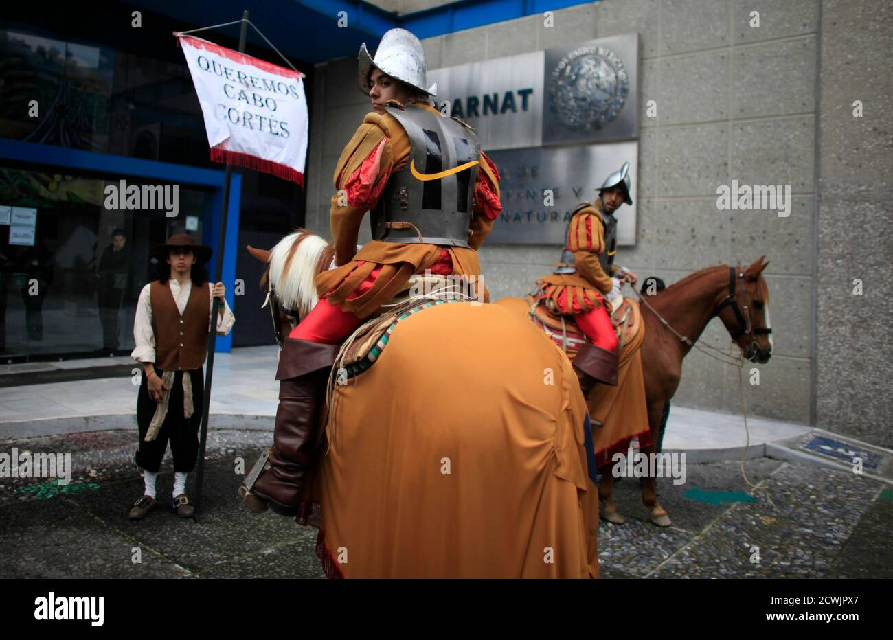 Greenpeace activists dressed as Spanish conquerors protest against Spanish real estate developer Hansa Urbana outside the Secretary for Environment and Natural Resources office in Mexico City August 25, 2010. Hansa Urbana is planning to build a tourist complex called Cabo Cortez in Baja California, near the Cabo Pulmo nature reserve. REUTERS/Eliana Aponte (MEXICO - Tags: ENVIRONMENT CIVIL UNREST BUSINESS TRAVEL POLITICS) Stock Photo