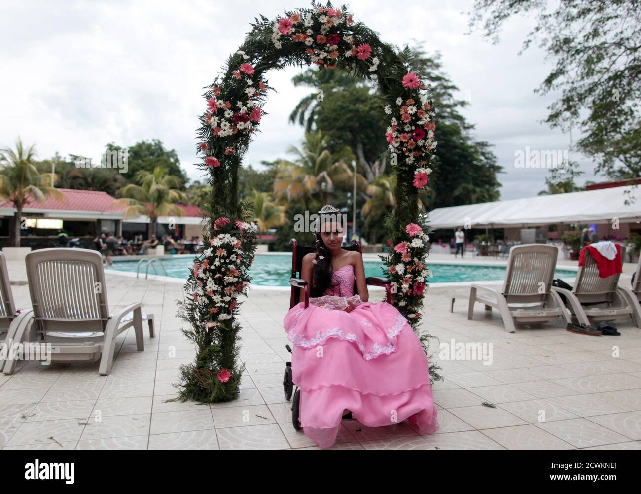 """A cancer patient poses for a photo during her """"Quinceanera"""" (15th birthday) party at a hotel in Managua September 20, 2014. Quinceaneras are a traditional celebration for girls turning 15. The Nicaragua's Association of Mother and Father of Children with Leukemia and Cancer (MAPANICA) organizes quinceaneras for cancer patients annually, and there were 44 celebrants in 2014. Picture taken September 20, 2014. REUTERS/Oswaldo Rivas (NICARAGUA - Tags: HEALTH SOCIETY TPX IMAGES OF THE DAY) Stock Photo"""