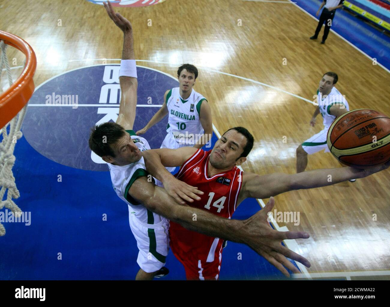 Iran's Saeid Davarpanahfard (centre R) goes up to shoot against Slovenia Goran Jagodnik during their FIBA Basketball World Championship game in Istanbul September 2, 2010.       REUTERS/Jeff Haynes (TURKEY  - Tags: SPORT BASKETBALL) Stock Photo
