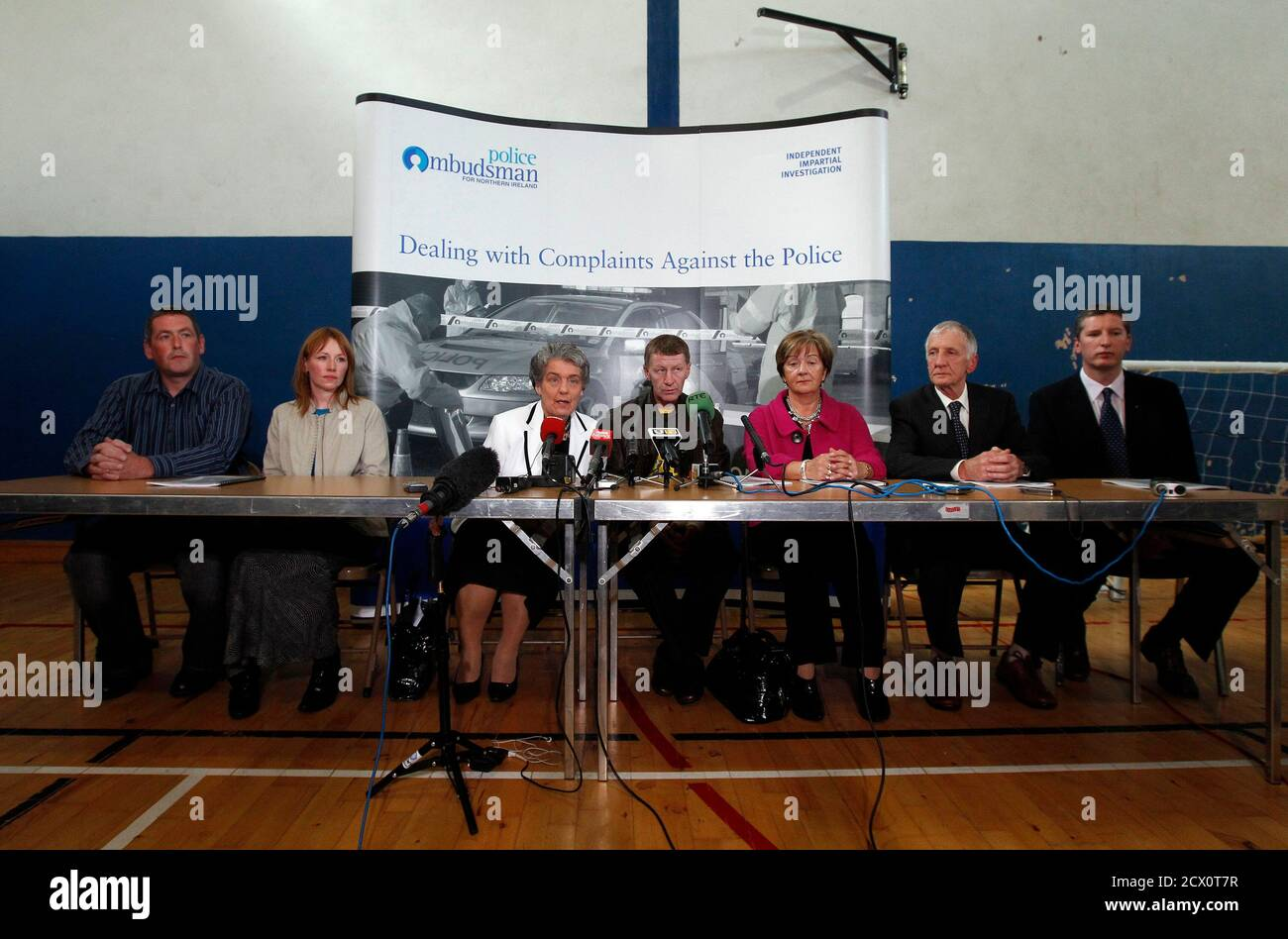 Victims and relatives (from L) Colm McClelland,Tracey Deans, Mary Hamilton, Mark Eakin, Marjorie Leslie, Gordon Miller, James Miller, of the 1972 bombings of Claudy speak during a news conference in Claudy, Northern Ireland August 24, 2010. The government, the police and the Catholic Church colluded to protect a priest suspected of involvement in a 1972 bombing in Northern Ireland that killed 9 people, a report said on Tuesday.The Police Ombudsman's eight-year probe revealed a cardinal was involved in moving Father James Chesney out of Northern Ireland, highlighting anew the way the Church hie Stock Photo