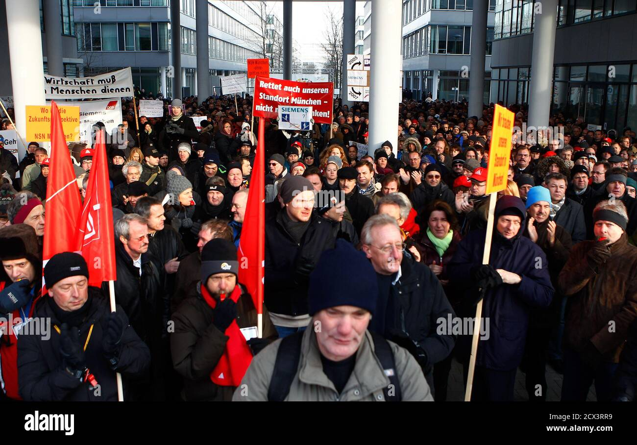 Employees of Nokia Siemens Networks (NSN) demonstrate in front of the German headquarters of NSN against job cuts in Munich February 1, 2012. Nokia Siemens Networks, the world's No.2 maker of mobile telecoms network equipment, plans to cut 4,100 jobs in its home countries of Finland and Germany as part of a cost-cutting drive aimed at coping with competition and weak demand.      REUTERS/Michael Dalder   (GERMANY - Tags: BUSINESS EMPLOYMENT TELECOMS) Stock Photo