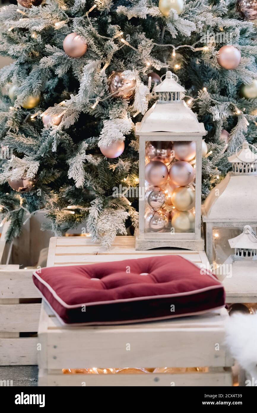 Lantern With Holiday Baubles On Decorated Christmas Tree Background In Living Room Interior Winter Time And Lamp On Wooden Sofa Near Christmas Tree Stock Photo Alamy