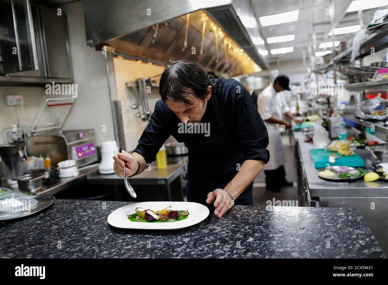 Matteo Boglione Executive Chef Of Le Cirque Signature Restaurant Prepares A Dish Inside The Kitchen In Mumbai December 7 2013 The Branch Of New York S Venerable Le Cirque At The Leela Mumbai