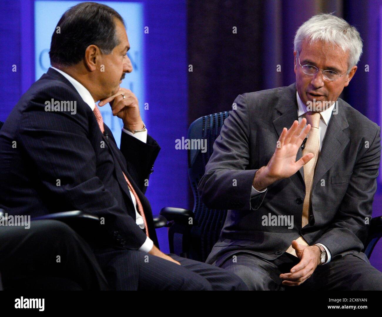 """Andrew Liveris (L), Chairman and Chief Executive Officer of The Dow Chemical Company, listens as Peter Sands, Group Chief Executive for Standard Chartered Bank, speaks with television reporter Maria Bartiromo of CNBC (not pictured) during the taping of a program titled """"Meeting of the Minds,"""" at the Clinton Global Initiative in New York September 22, 2010.  REUTERS/Chip East (UNITED STATES - Tags: POLITICS BUSINESS SOCIETY) Stock Photo"""