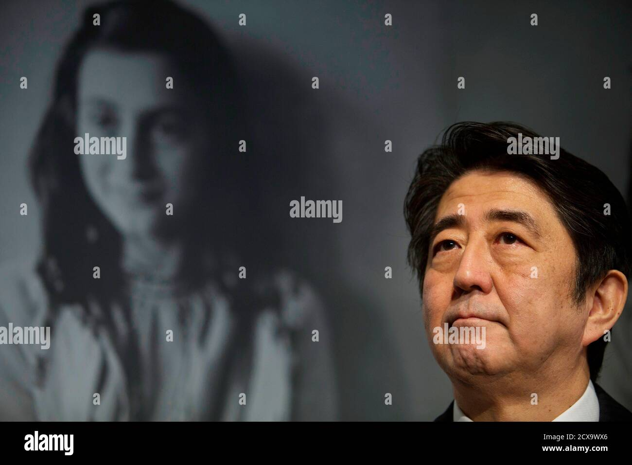Japan's Prime Minister Shinzo Abe visits the Anne Frank House museum in Amsterdam March 23, 2014.  Abe visited the Anne Frank House museum on Sunday to highlight Japan's friendship with the Jewish people and sees no contradiction with his recent controversial visit to the Yasukuni Shrine at home. REUTERS/Cris Toala Olivares (NETHERLANDS - Tags: POLITICS) Stock Photo
