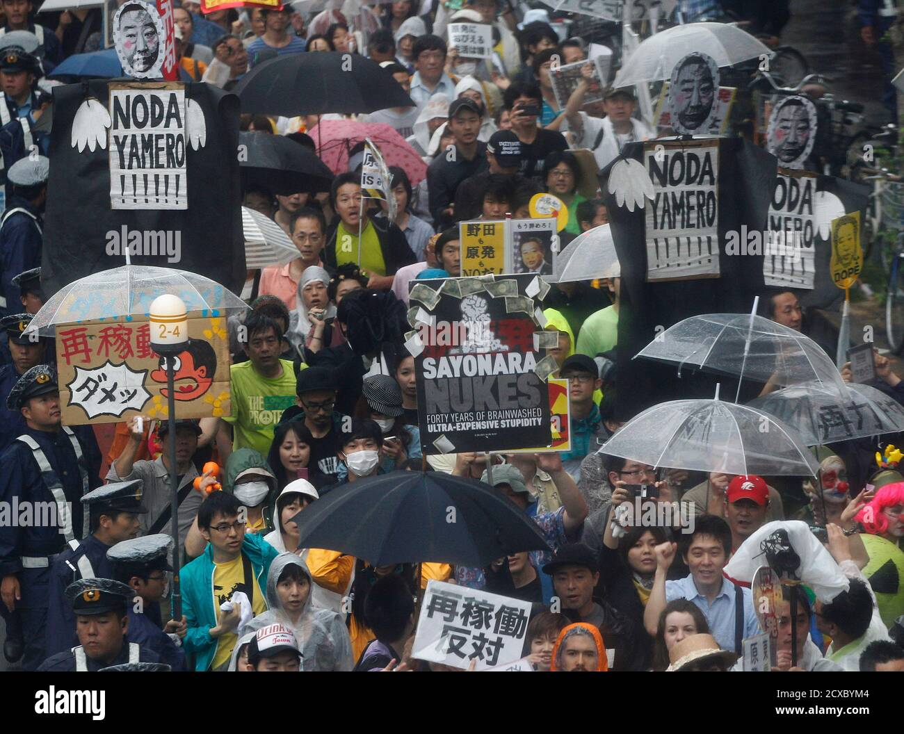 Protesters take part in an anti-nuclear demonstration demanding a stop to the resumption of nuclear power operations in Tokyo July 1, 2012. Japan has approved the restart of the two reactors at the Kansai Electric Power Ohi nuclear plant, northwest of Tokyo on Sunday despite mass public opposition. Kansai Electric Power Co plans to restart the 1,180-megawatt No.3 unit at its Ohi plant, Japan's first nuclear reactor to come back online since the Fukushima crisis. REUTERS/Yuriko Nakao (JAPAN - Tags: POLITICS CIVIL UNREST) Stock Photo