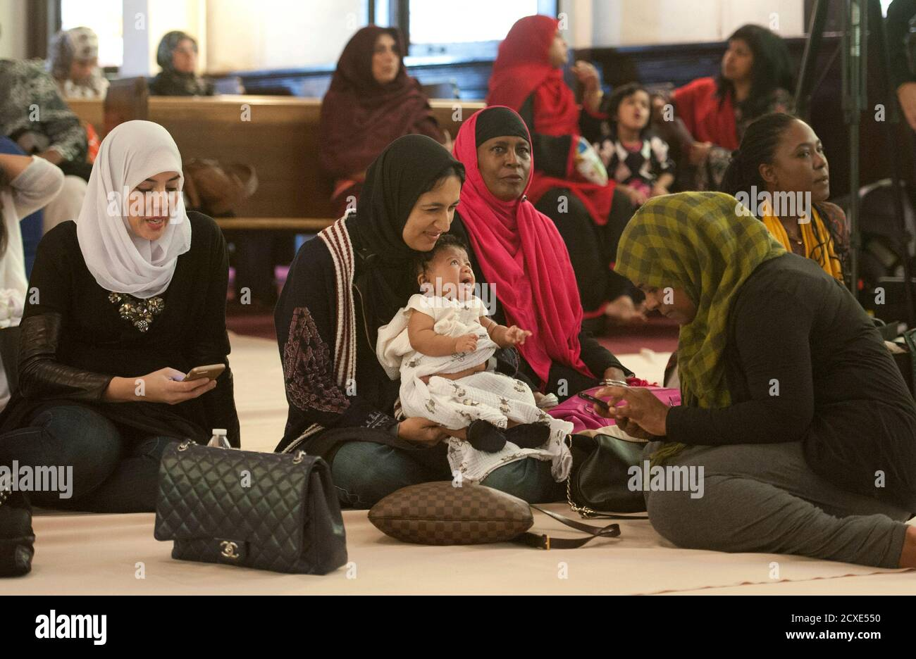 Women wait for the prayer service at the Women's Mosque of America in downtown Los Angeles, California January 30, 2015.  The first mosque in the United States to be solely dedicated to women launched with a women-led prayer service.  REUTERS/Lori Shepler   (UNITED STATES - Tags: RELIGION SOCIETY) Stock Photo