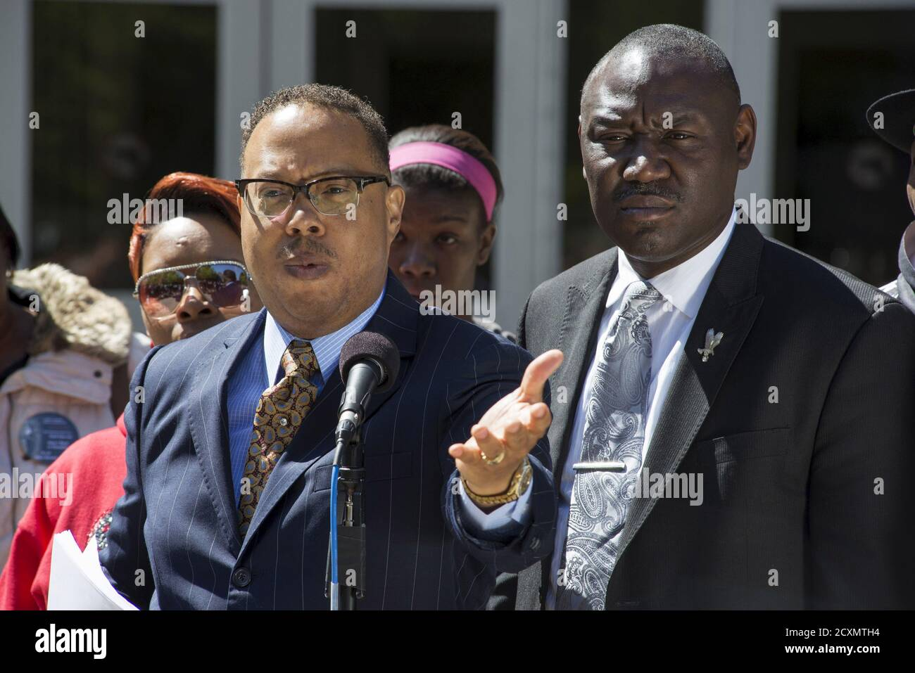 Michael Brown's family lawyers Anthony Gray (C) and Benjamin Crump (R), stand with his mother Lesley McSpadden (L) as they announce the Brown family has filed a wrongful death lawsuit against the city of Ferguson in front of the St. Louis County Circuit Court in Clayton, Missouri, April 23, 2015. The family of Michael Brown filed a wrongful death lawsuit against the city of Ferguson on Thursday, seeking unspecified damages and police reforms after the black teen's killing by a white policeman prompted a national debate on law enforcement and race. REUTERS/Kate Munsch Stock Photo
