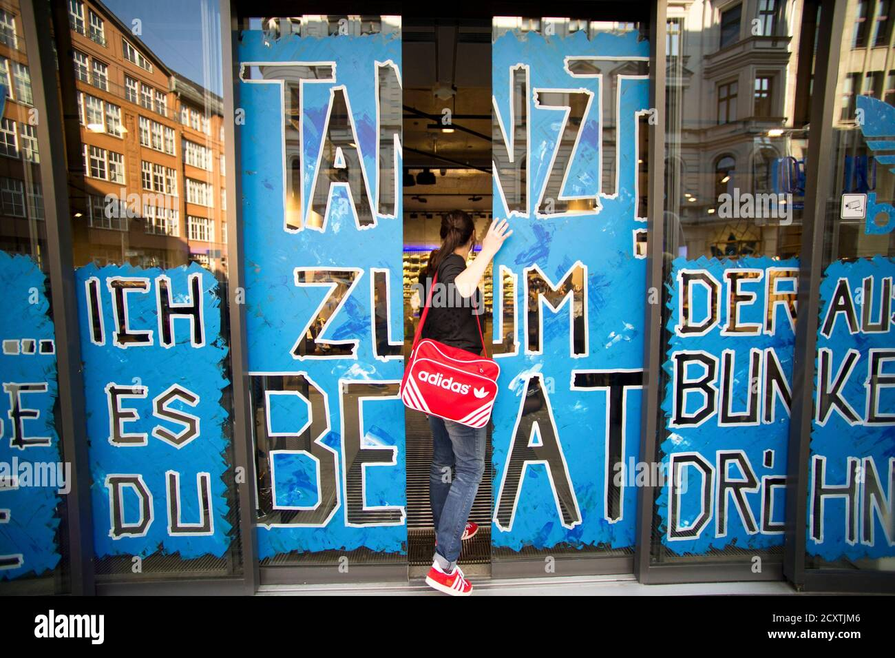 Bosque Madison Motel  A worker enters the new Adidas Originals store in Berlin March 27, 2014.  Adidas has launched