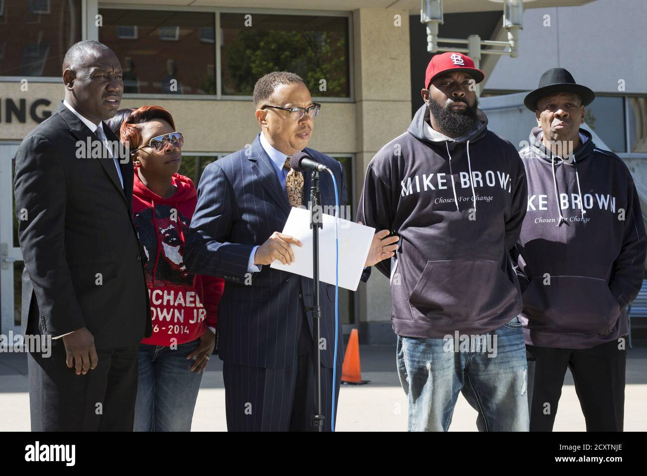 Michael Brown's family lawyers Anthony Gray (C) and Benjamin Crump (L), stand with his mother Lesley McSpadden (2nd L) and father Michael Brown Sr., as they announce the Brown family has filed a wrongful death lawsuit against the city of Ferguson in front of the St. Louis County Circuit Court in Clayton, Missouri, April 23, 2015. The family of Michael Brown filed a wrongful death lawsuit against the city of Ferguson on Thursday, seeking unspecified damages and police reforms after the black teen's killing by a white policeman prompted a national debate on law enforcement and race. REUTERS/Kate Stock Photo