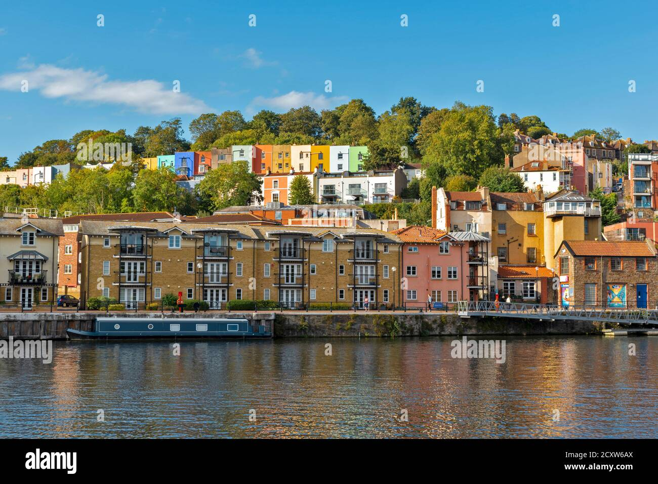 BRISTOL CITY ENGLAND HOTWELLS DOCKS THE COLOURED HOUSES OF CLIFTON WOOD AND AMBRA VALE AND WATERSIDE HOUSES OF ROWNHAM MEAD POOLES WHARF AREA Stock Photo